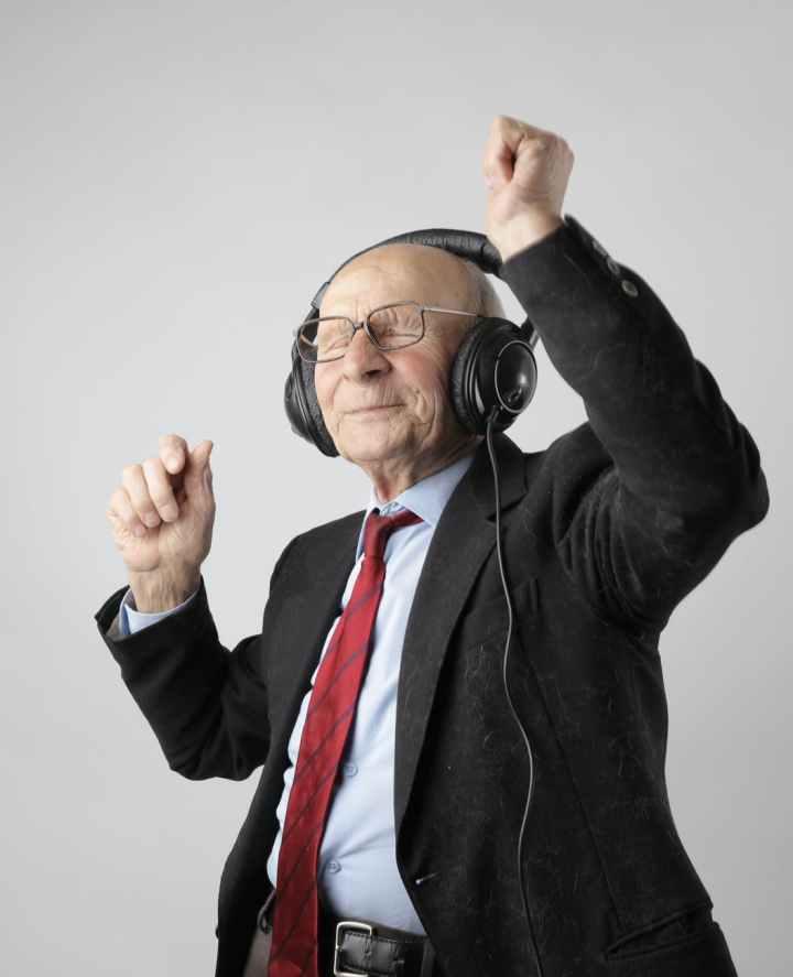 man in black jacket wearing black headphones